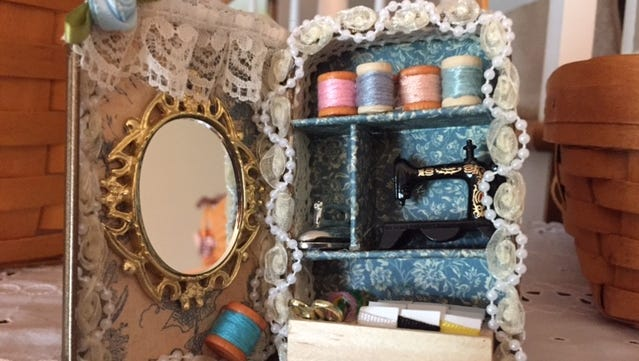 Sewing room diorama made from an Altoid Tin.