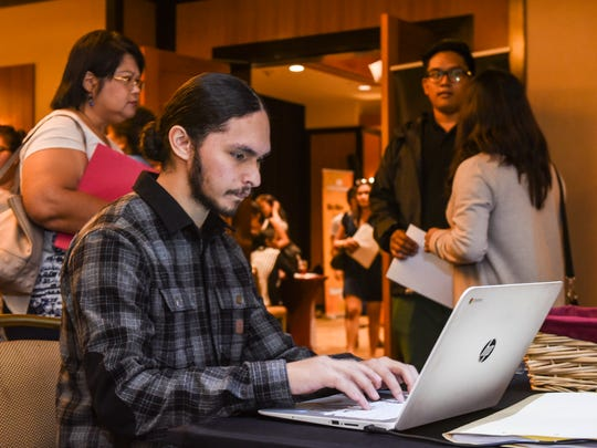 Job seeker Anthony Marques of Barrigada logs in on a GuamTemps Employment Services laptop in an attempt to secure employment during the Guam Chamber of Commerce's Chamber Business Women Network 3rd annual Job Fair at the Westin Resort Guam in Tumon on Thursday, Feb. 1, 2018.