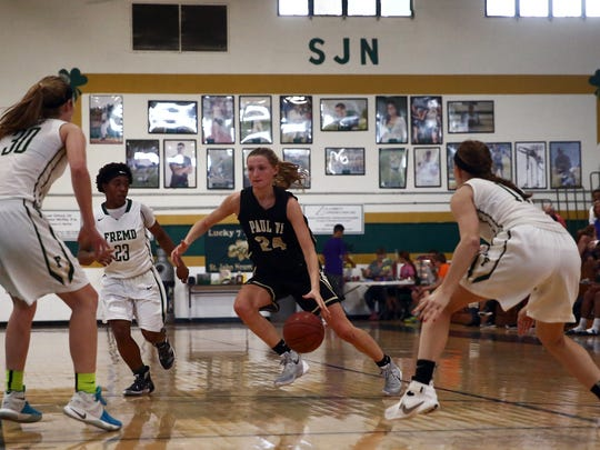 Paul VI sophomore Kate Klimkiewicz runs the ball against Fremd players during the Naples Holiday Shootout at St. John Neumann Catholic High School on Wednesday, Dec. 30, 2015. Paul VI defeated William Fremd with a final score of 60-42.