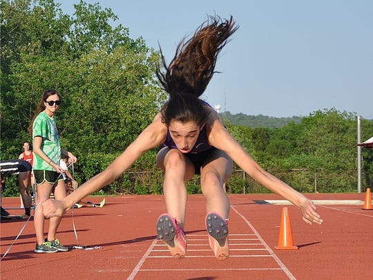 Clarkstown North's Emily Cahill stretches for landing