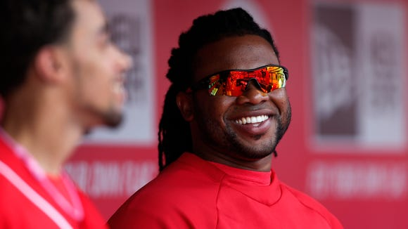 Reds starting pitcher Johnny Cueto talks with outfielder Billy Hamilton (left).