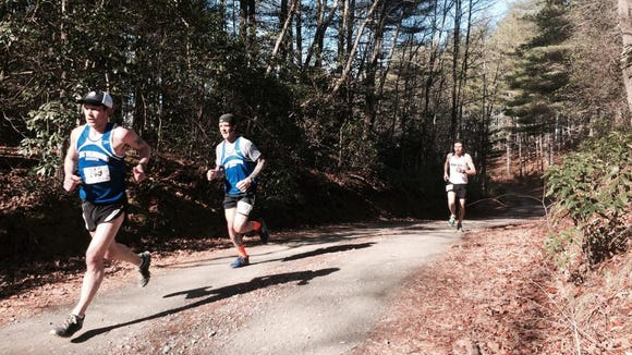 More than 200 runners took part in the Jus' Running DuPont Forest 12K Trail Race Saturday.