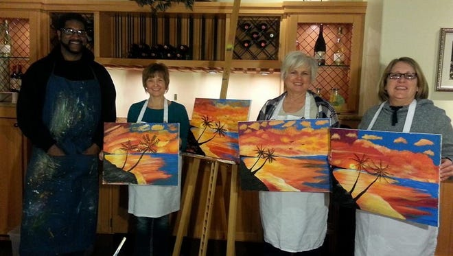 Artist Ron Deane, left, with some members of his Paint @ the Garden class at Olive Garden in Richmond.
