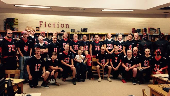 Andrews football players shaved their heads as a sign of support for Korbin Smith in October.