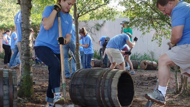 Volunteers built a walking trail and installed a new playground, a sitting area and granite benches at the SafePlace shelter in Austin for Make A Difference Day in October.