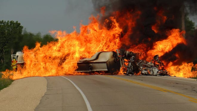 Firefighters are battling a semi-tractor trailer fire that stretches across Highway 33 near Noble Road east of Horicon on Thursday, July 16.
