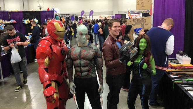 A group of cosplayers at FanX 2015 are dressed as Iron Man, Drax, Star-Lord and  Gamora.