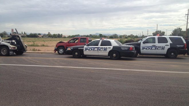 Mesa police officers arrested a man they believe stole this red Chevy truck.