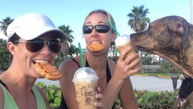 Natalie Dorfeld and Shannon Mulvaney, as well as Mulvaney's dog Daisy Mae, enjoy pumpkin spice drinks and pumpkin cookies from Starbucks.