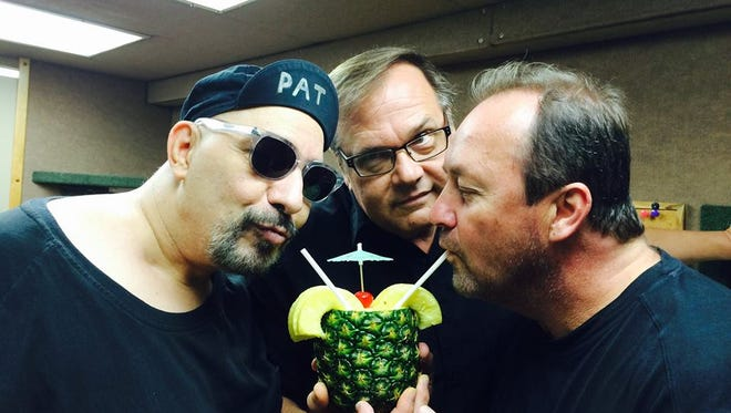 Pat DiNizio enjoys a refreshing drink with Dennis Diken and Jim Babjak of the Smithereens.