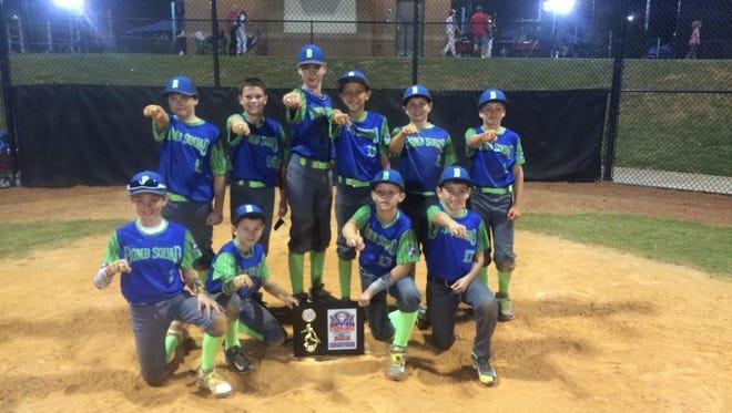 The Bomb Squad 11U baseball team and its coaches.