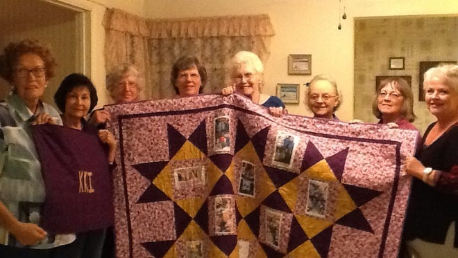 Alice Money, past president of the Nu Chapter of Kappa Kappa Iota, was presented at the October meeting with a Memory Quilt to commemorate her tenure as president of the sorority from September 2010 to May 2015. Helping hold the large quilt are (left to right) Barbara Telles, Barbara McLemore, Rita Weitzel, Judy Ann Medeiros, Margie Aquayo, Alice Money, Mary Hester and Pat Trautman.