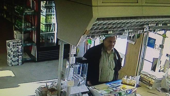 The New Jersey State Police posted on Facebook this surveillance photo from Lakeland Liquor Store in Victory Gardens of a suspect allegedly purchasing beer with a found credit card.