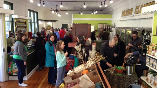 Customers explore the new Goodside Grocery space during the grand re-opening.