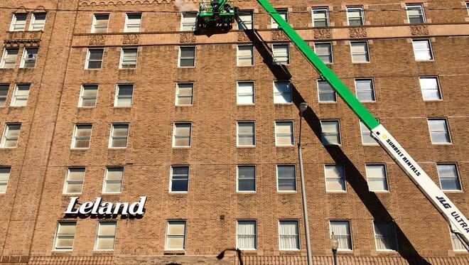Workers from local company Beard Masonry are currently tuck pointing the Leland Legacy.