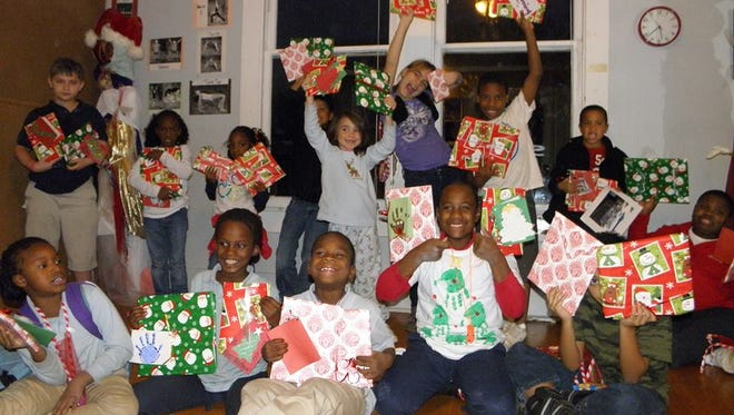 Renzi Education and Art Center students with holiday gifts.