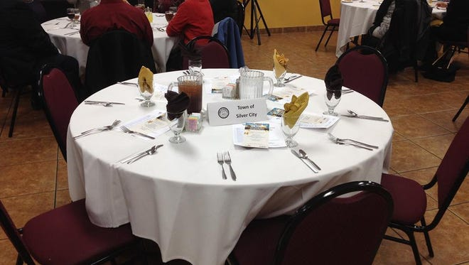 Town of Silver City empty table at community awards banquet on Thursday.