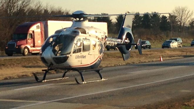 A helicopter lands on Interstate 81 Wednesday afternoon to transport a patient involved in a fatal accident involving a tractor-trailer at mile marker 20 southbound in Greene Township.