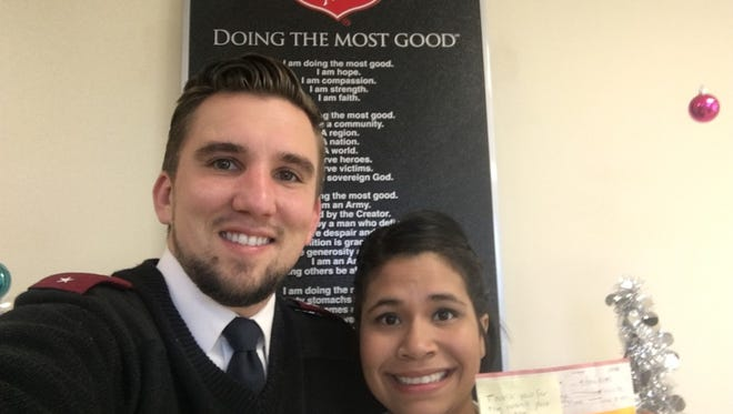 Lts. Ryan and Amber Meo of the Salvation Army of Tallahassee found a $1,000 check in one of the nonprofits red kettles.