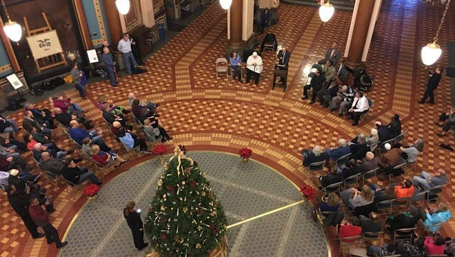 Approximately 125 people attended a community prayer in the Capitol rotunda on Sunday, Dec. 13.