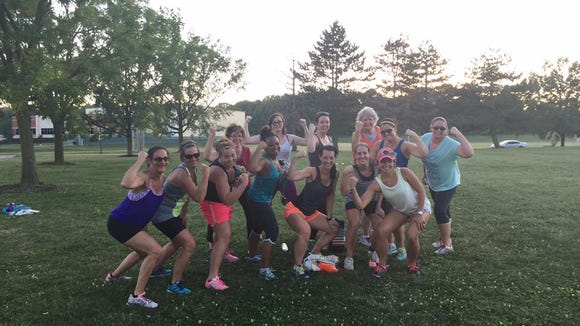 No Sweat bootcampers show off their muscles after the 2015 No Sweat in the Park bootcamp.