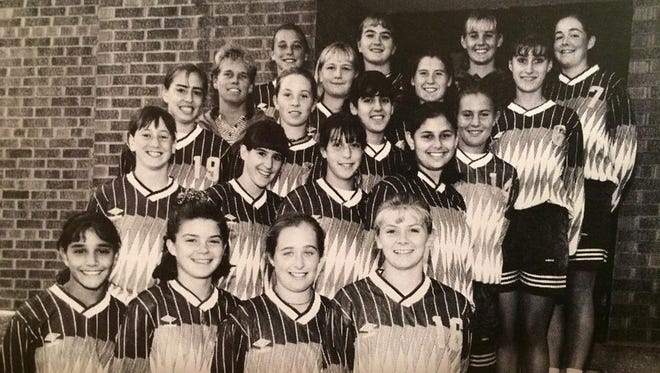 The 1995 Mercy soccer team, including Abby Wambach, seen in the top row at far left, won the Section V Class A championship behind Wambach's two goals and the penalty kick save she made late in regulation to preserve the win.