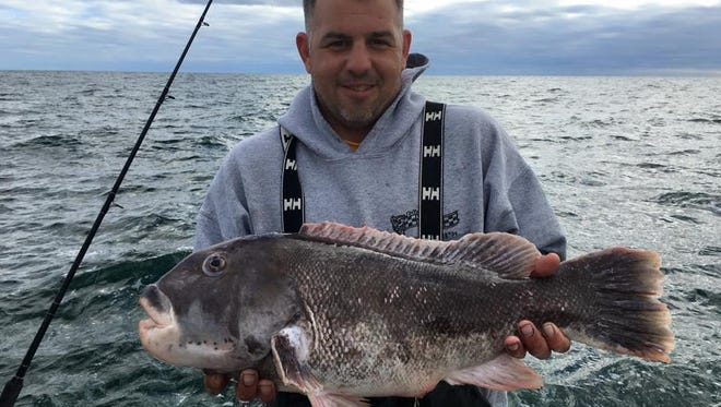 Thomas Fariello with a blackfish he caught on the Fish Stix.
