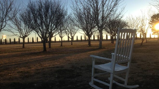 This empty chair is highlighted by a New Mexico sunset on Sunday at the St. Clair Winery located east on NM Highway 549.