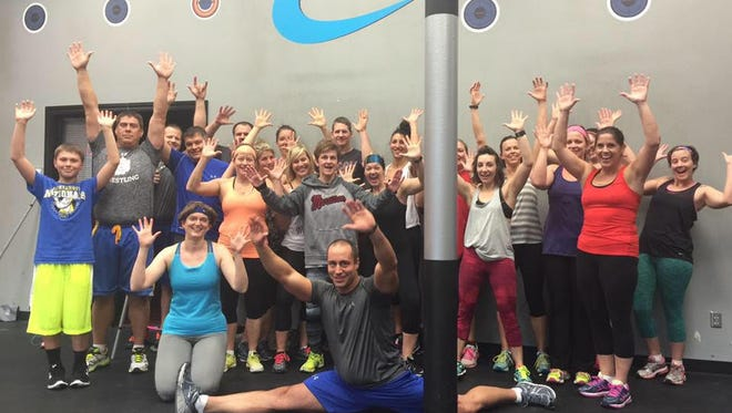 Participants celebrate at the Exercise Your Gratitude fundraiser at  CMFitness in the Western Mall.