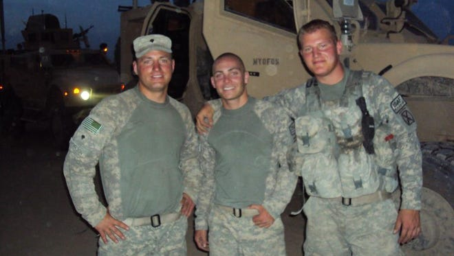 "From left, Spc. Brian ""Bucky"" Anderson, PFC Chase Gray and PFC Derek Bartok served together in Afghanistan. Bucky didn't make it home."