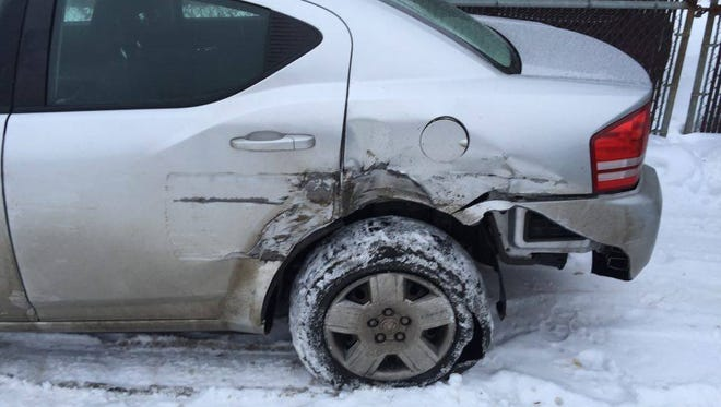 Brent Clouser's vehicle, as pictured after a collision with a snow plow at the intersection of Russell Street and Western Avenue.