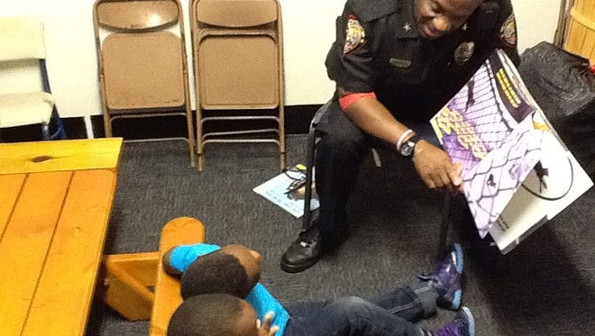 Deputy Chief Vincent Pryce of the Melbourne Police Department participates in last year's Black History read-in at Mt. Moriah Missionary Baptist Church
