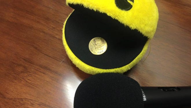 """Pac-Man can't keep his mouth shut on the latest """"Best Podcast in the World."""" Good thing he found an original Aladdin's Castle coin to chew on."""