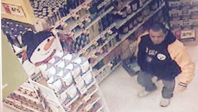 Police say the man pictured here stole hundreds of dollars worth of Snapple and energy thief.
