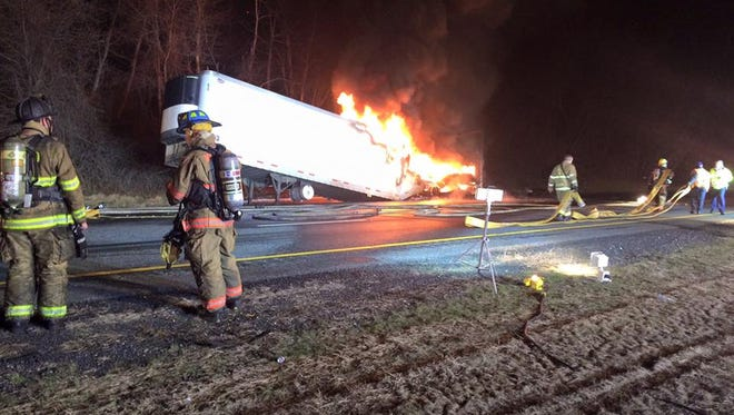 Firefighters work on the scene of a tractor-trailer fire on Interstate 83 north in Baltimore County, Maryland, on Friday morning.