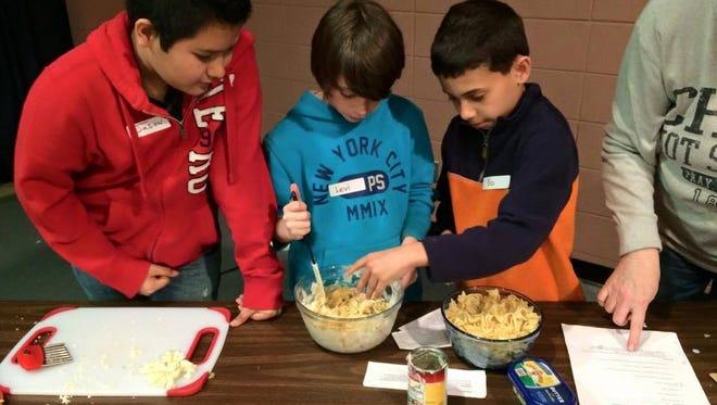 Hall Fletcher kids prepare food.