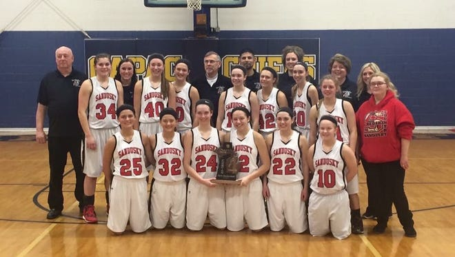 The Sandusky High School girls basketball team celebrates its second straight district title