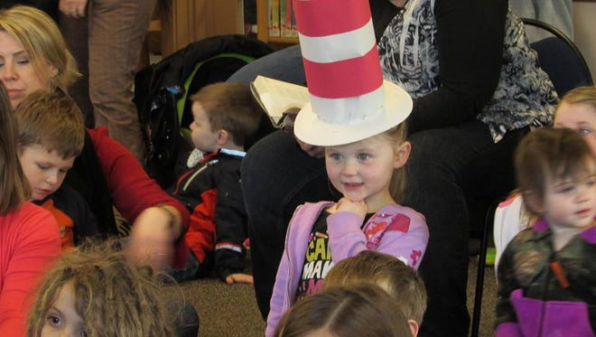 """Wednesday, March 2, was the National Education Association's """"Read Across America Day."""" The library?s event commemorated Dr. Seuss' would-be 112th birthday, and the day?s theme was """"Grab your Hat and Read with the Cat."""""""