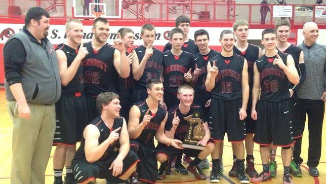 Sandusky poses with the boys basketball district trophy after topping Marlette, 37-33.