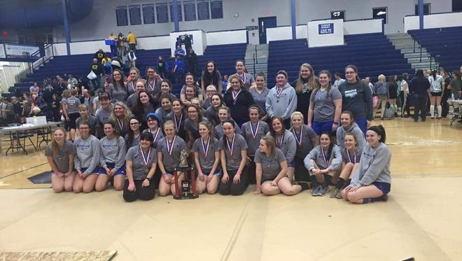 The Croswell-Lexington girls powerlifting team poses for a photo after its state championship