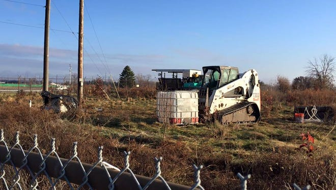 A cleanup crew excavates soil at a RACER Trust site in Lansing. The EPA has given the Lansing Regional Brownfield Coalition a $500,000 grant to help identify hazardous substances at contaminated sites in the tri-county area.