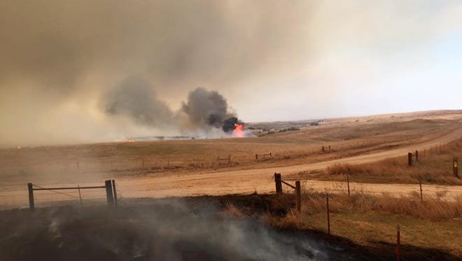 Volunteer firefighters from the Dewey County Task Force work a blaze southwest of Freedom, Okla. on April 5, 2016. Oklahoma Forestry Services Director George Geissler says arcing power lines are to blame for the blaze in northwest Oklahoma, located about 170 miles northwest of Oklahoma City.