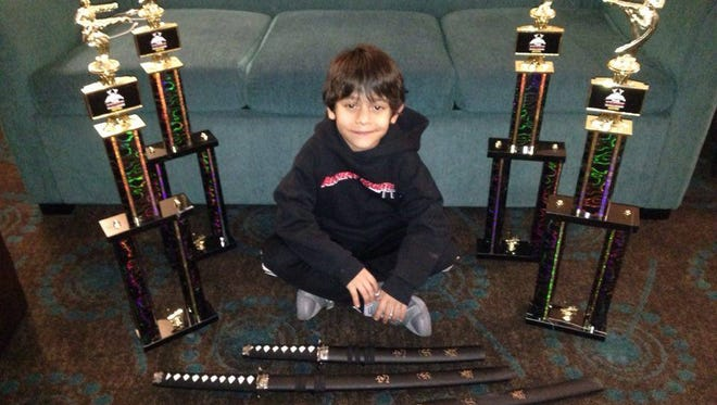 Christian Jeremy Alvarado won five awards, including trophies and swords, at the Intermountain Karate Challenge on March 19 in Salt Lake City. The 6-year-old El Paso karate champion earned honors for sparring, creative form, creative form with weapons, team sparring and grand champion.