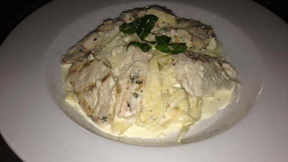 Rosemary chicken alfredo with homemade noodles, served at the Old 10 Bistro.
