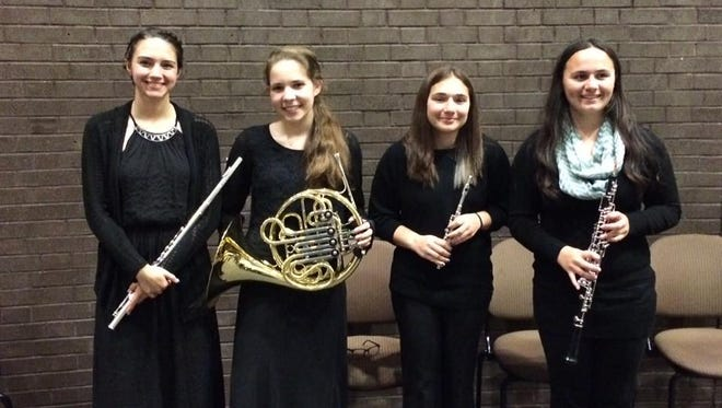 (From left) Julia Terry, Lacey Taylor, Alexia Bartleson and Kaci Georgis, students at Millville High School, performed in the Rowan Youth Orchestra Concert on May 1.
