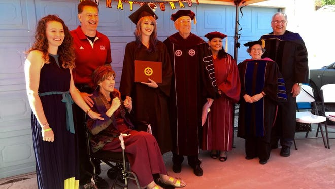 A special graduation ceremony was held Saturday morning for NMSU student Tiffany Diaz, one week ahead of her classmates. Pictured, from L-R, is Tiffany's sister, Jessica Dixon, Dennis & T.J. Diaz, Tiffany, NMSU Chancellor Garrey Carruthers, Student Regent Amanda Lopez Askin, Hotel, Restaurant and Tourism Management Department Head Jean Hertzman and Interim Dean of NMSU's College of Agriculture, Consumer and Environmental Sciences Jim Libbin. The ceremony took place in the driveway of Dennis & TJ Diaz's Las Cruces home.