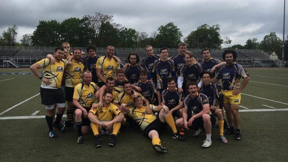 The La Salle men's rugby team (in blue) and a handful of alumni after Saturday's game.