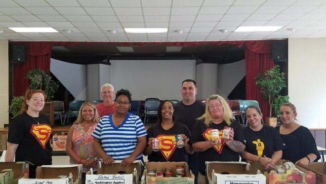 Amazon volunteers recently  partnered with Upstate Family Resource Center for a food drive.