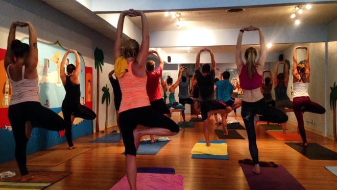 This is the final week of Mindful May! Join the movement with a variety of classes in North Brevard County this week. Photo: Flow Yoga class at Downtown Yoga's Melbourne location.