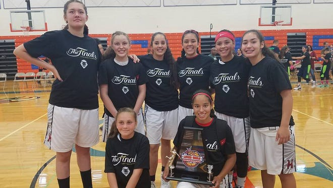 The El Paso Hustle girls basketball team won the Latino World Championships eighth-grade division June 5, beating the El Paso Wild in the finals. Natalia Perez was named the tournament's Most Valuable Player. Team members are, top, Camila Contreras, Iliana Vigil, Sierra Aguilar, Natalia Perez, Victoria Perez and Jessica Amezaga, and bottom, Sophiya Bustillos and Adryan Alvarez. El Paso Hustle is coached by Carlos Contreras, Eric Alvarez and Angie Bustillos.
